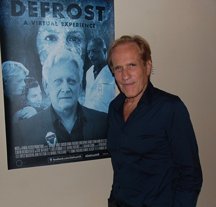 "Randal Kleiser standing next to the poster for ""Defrost"""