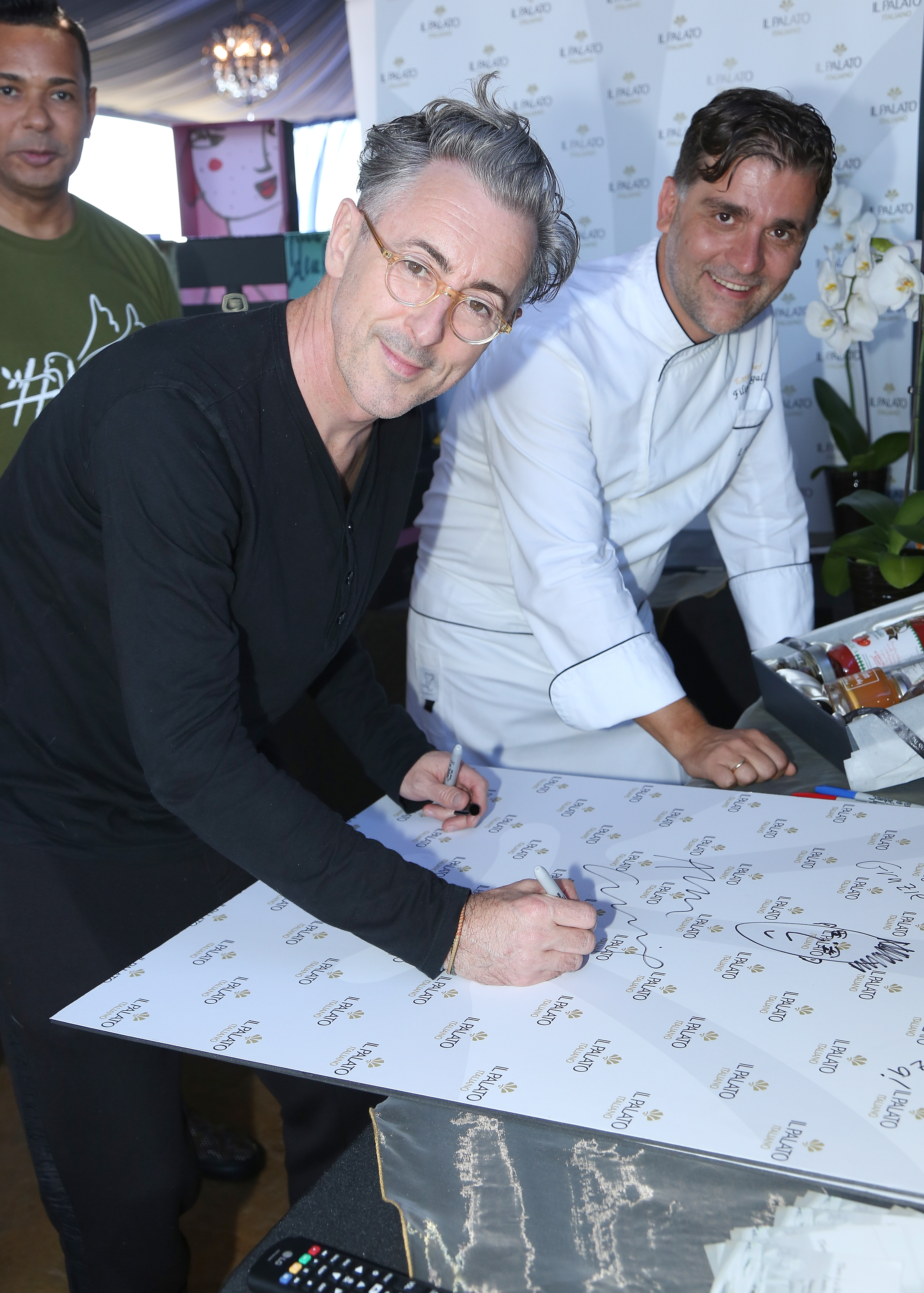 Actor Alan Cumming and chef Filippo Sinisgalli (Photo by Maury Phillips/Getty Images for GBK Productions)