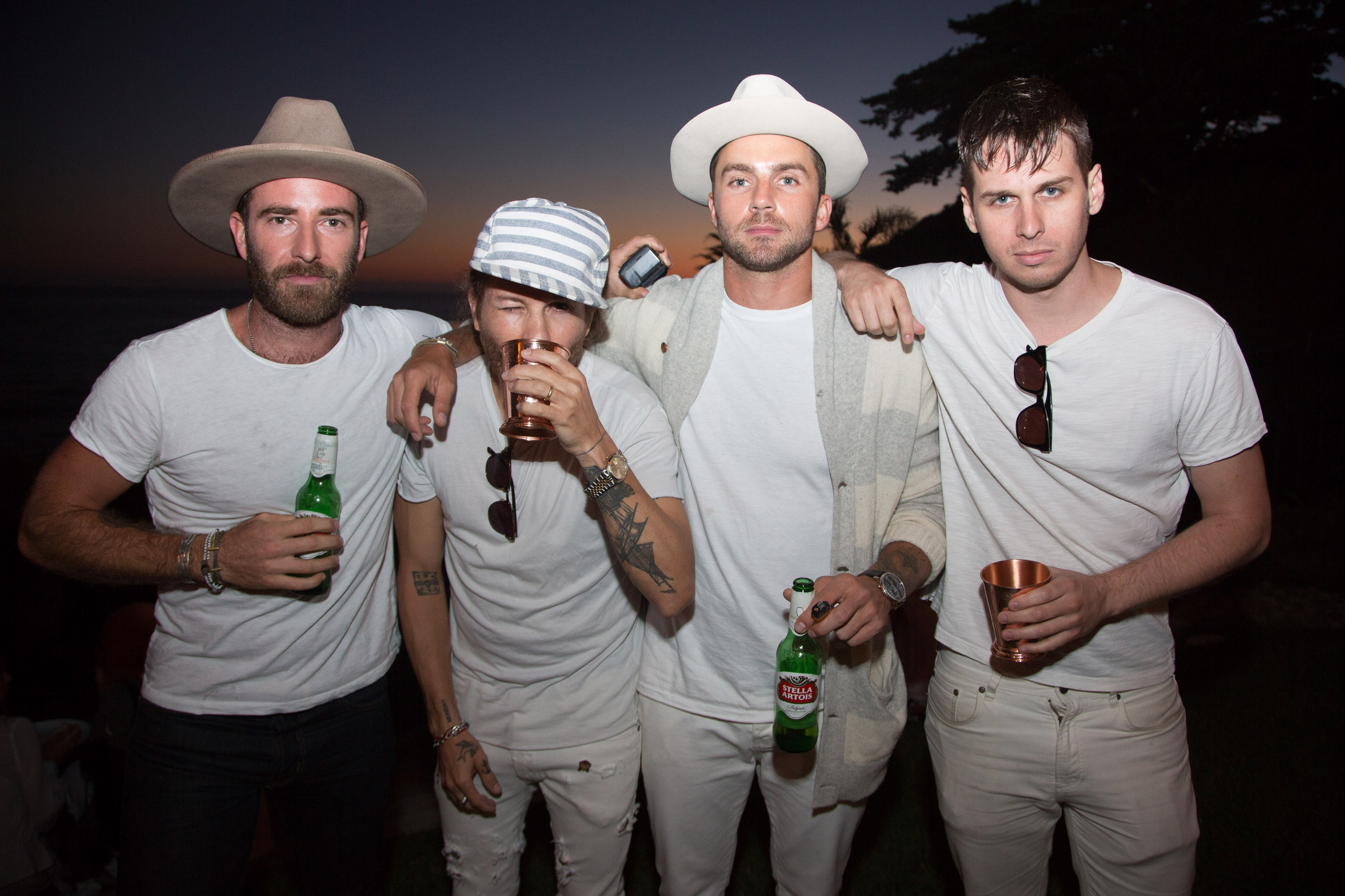 MALIBU, CA - SEPTEMBER 17: Mark Foster (R) of Foster the People and guest attend the Treats! Magazine 4th Annual White Party Sponsored By Stella Artois on September 17, 2016 in Malibu, California. (Photo by Gabriel Olsen/WireImage)