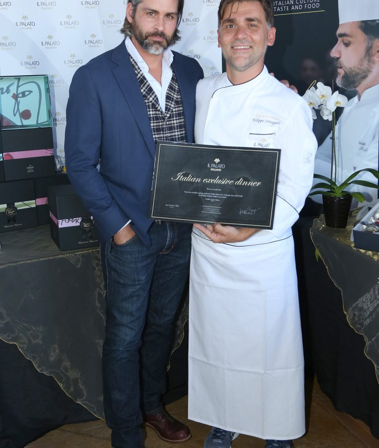 Actor Riley Schmidt and chef Filippo Sinisgalli  (Photo by Maury Phillips/Getty Images for GBK