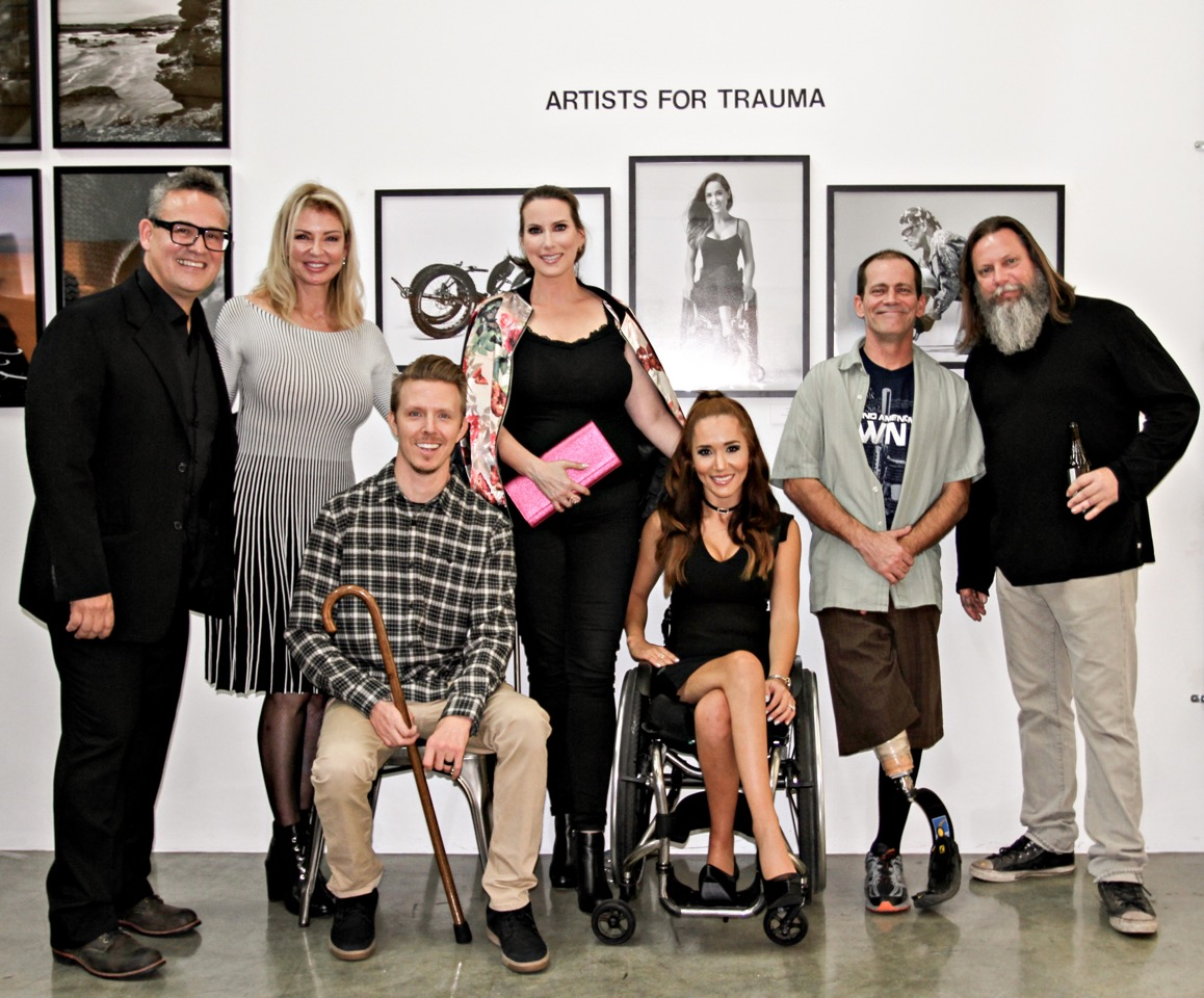 From left to right Per Bernal - World renowned artist, Laura Sharpe - Artists for Trauma Founder and CEO, Aaron Baker - AFT Ambassador/Model, Megan Phillips - Sur le Mur Founder, Tamara Mena - AFT Ambassador/Model Steve Bogna - AFT Ambassador/Model and Kelly 'Risk' Graval - world renowned artist. Photo courtesy of Kerstin Alm aka Mamarazzi