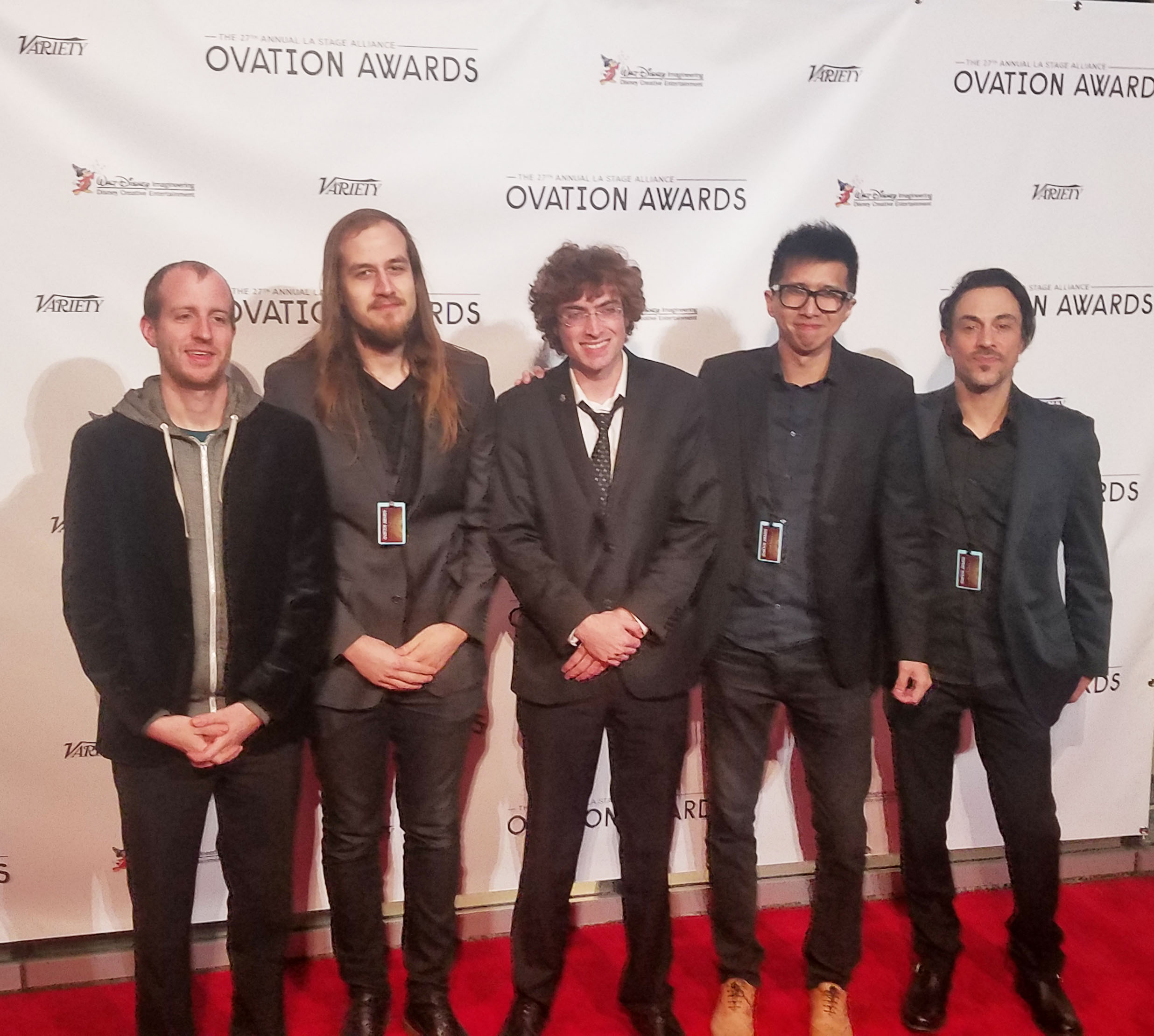 Christopher Raymond,(Center) on the red carpet with the band