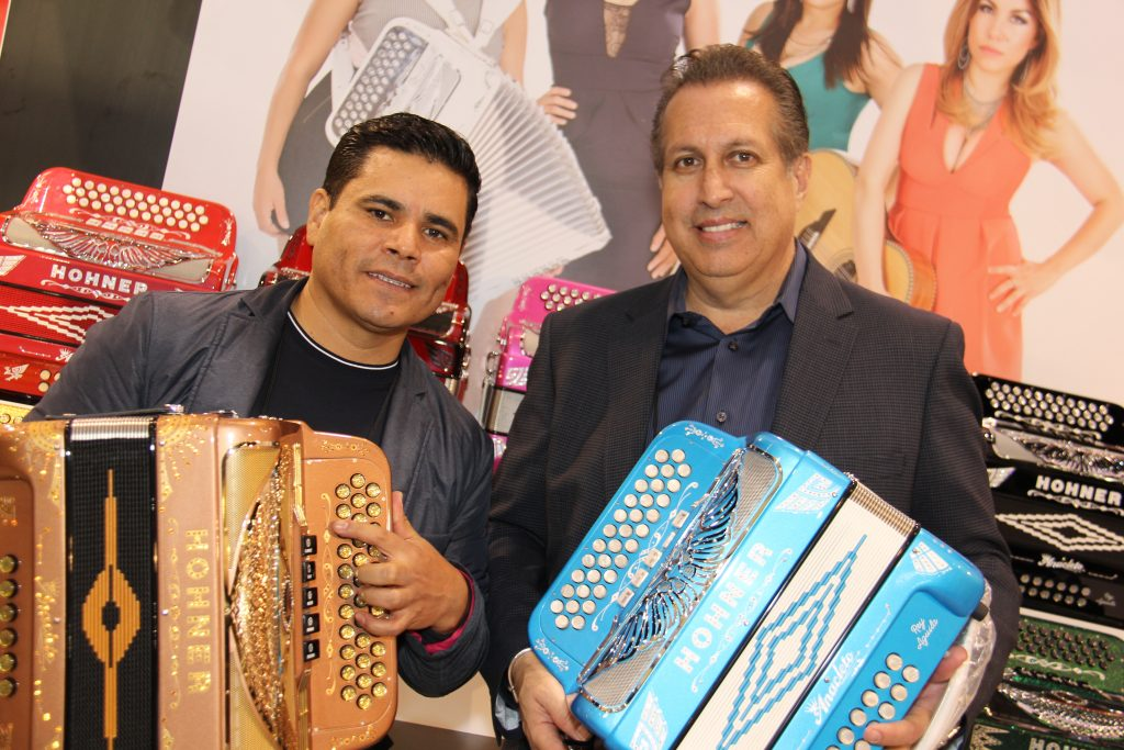 (L to R) Alfredo Gonzalez accordion player Los Tucanes de Tijuana with Gilberto Reyes Jr., Latin Inst. Business Mgr., Hohner [KHS America] (Photo by: Fredwill Hernandez/The Hollywood 360)