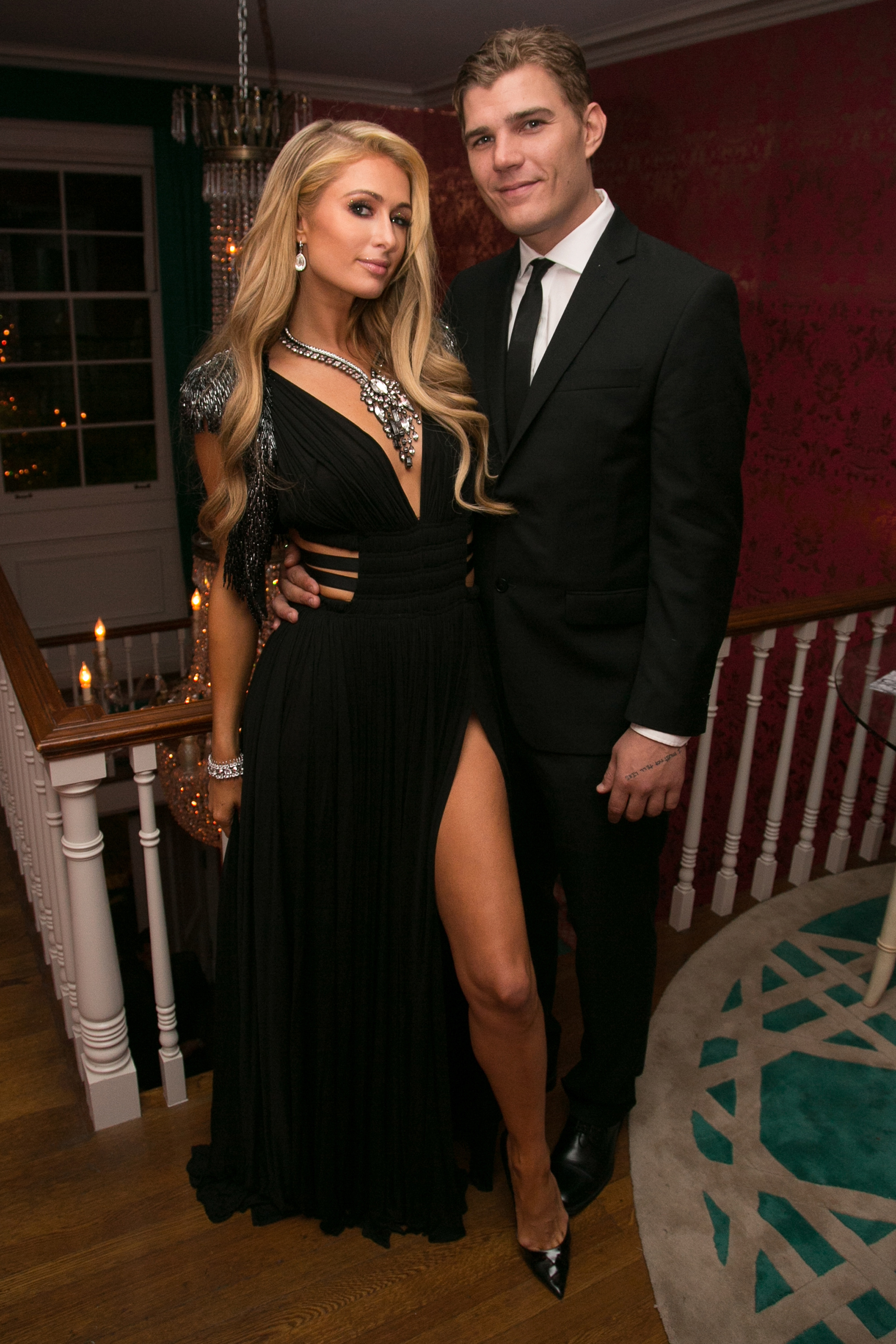 Paris Hilton (L) and Chris Zylka