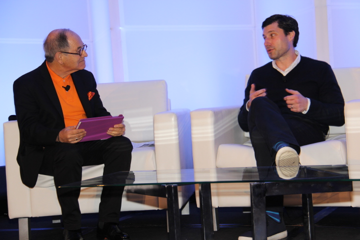 (L to R) Ralph Simon, Chairman, Mobilium Global as Brett Bouttier, Pres., Awesomeness TV, opens up (Photo by: Fredwill Hernandez/The Hollywood 360)