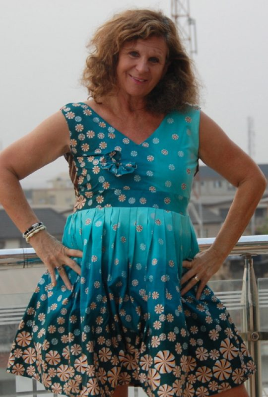 Sheryl Aronson in a dress by Oby African Fashions