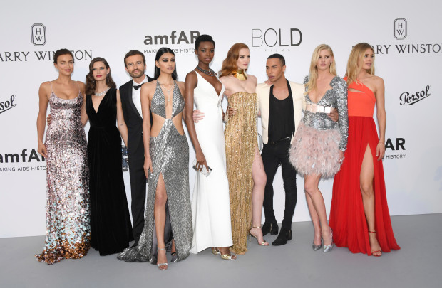 Models Doutzen Kroes, from left, Maria Borges, Irina Shayk, Bianca Balti, Neelam Gill, designer Olivier Rousteing, Alexina Graham and Lara Stone pose for photographers upon arrival at the amfAR charity gala during the Cannes 70th international film festival, Cap d'Antibes, southern France, Thursday, May 25, 2017. (Photo by Arthur Mola/Invision/AP)