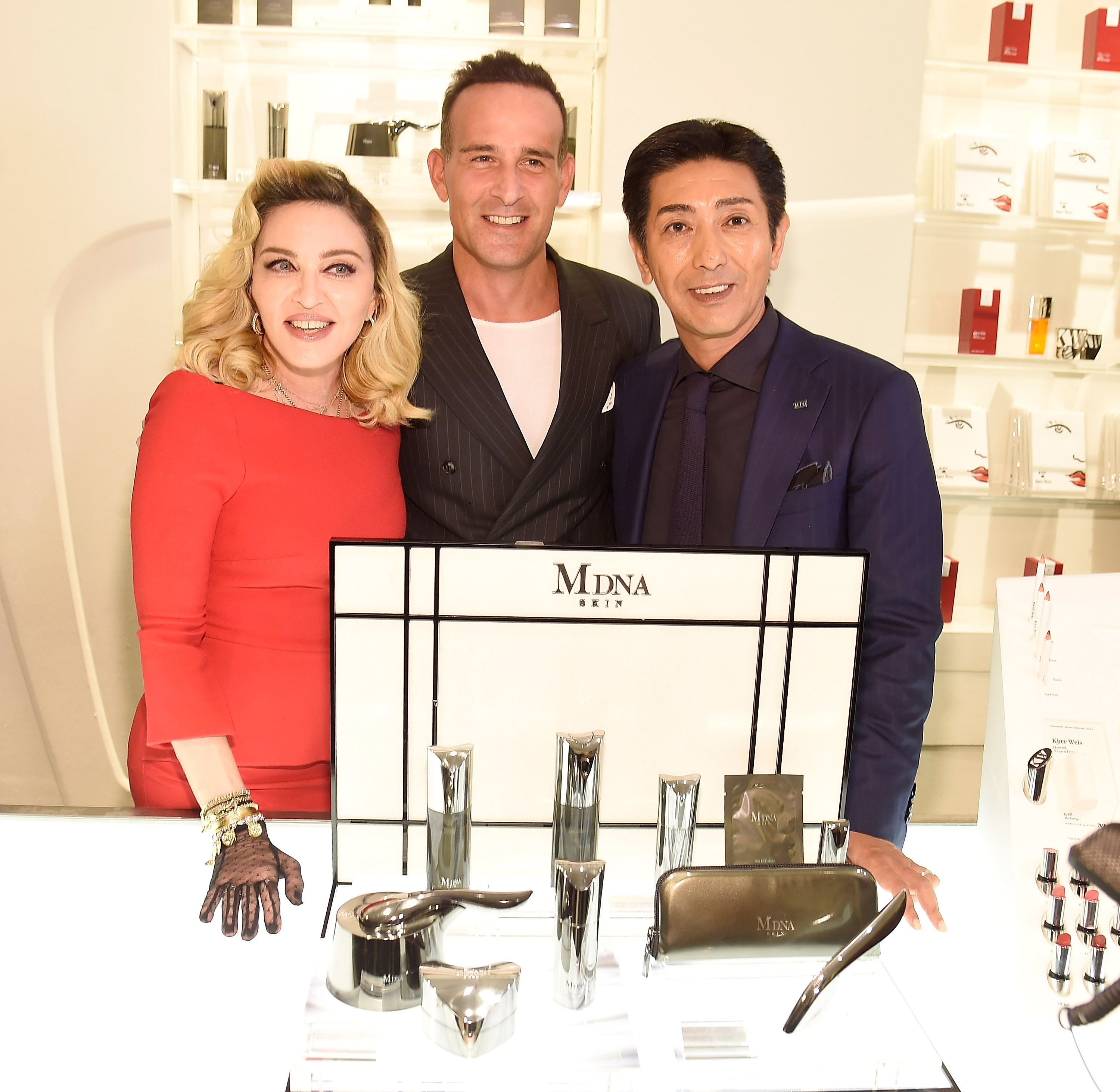 NEW YORK, NY - SEPTEMBER 26:  Dr Paul Jarrod Frank, Madonna and Tsuyoshi Matsushita, president of MTG Co., Ltd  launch MDNA SKIN collection at Barneys New York on September 26, 2017 in New York City.  (Photo by Kevin Mazur/Getty Images for MDNA SKIN)
