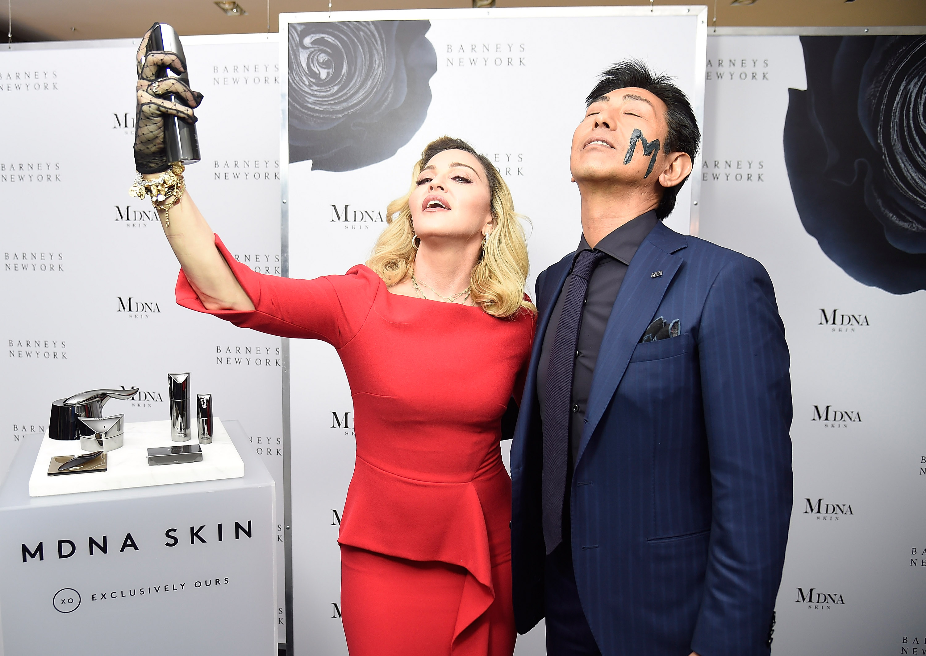 NEW YORK, NY - SEPTEMBER 26:  (Exclusive Coverage) Madonna and Tsuyoshi Matsushita, President of MTG Co., Ltd  launch MDNA SKIN collection at Barneys New York on September 26, 2017 in New York City.  (Photo by Kevin Mazur/Getty Images for MDNA SKIN)