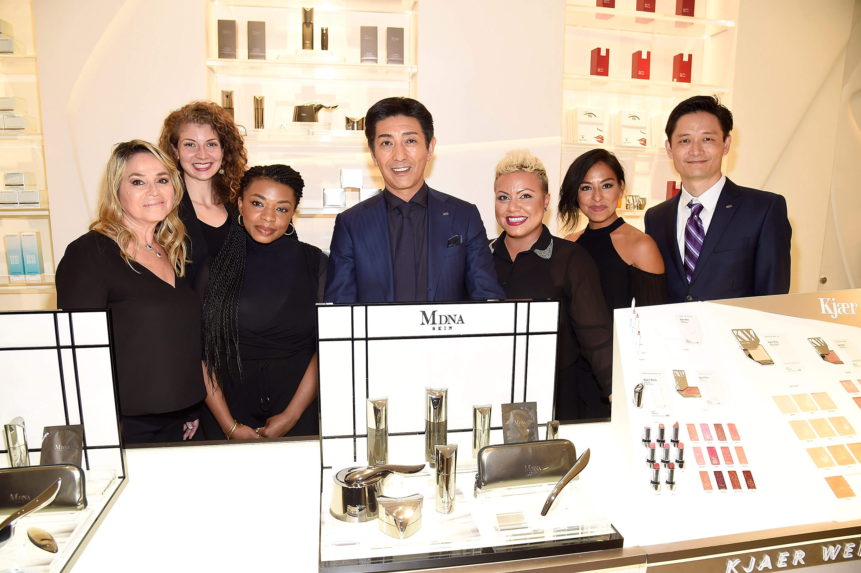 NEW YORK, NY - SEPTEMBER 26:   Tsuyoshi Matsushita, President of MTG Co., Ltd (C) during the launch of  MDNA SKIN collection at Barneys New York on September 26, 2017 in New York City.  (Photo by Kevin Mazur/Getty Images for MDNA SKIN)