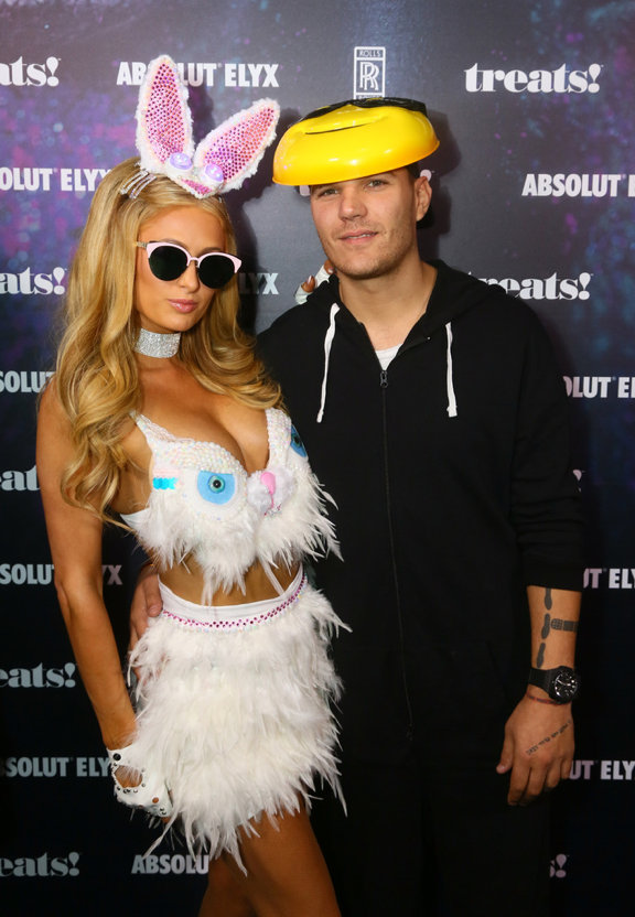 Paris Hilton and Chris Zylka attend treats! Magazine's 7th Halloween Party in Partnership with Rolls-Royce Black Badge, Absolut Elyx, & Perrier Jouet on October 31, 2017 in Los Angeles, California. (Photo by Gabriel Olsen/Getty Images for Treats Magazine)