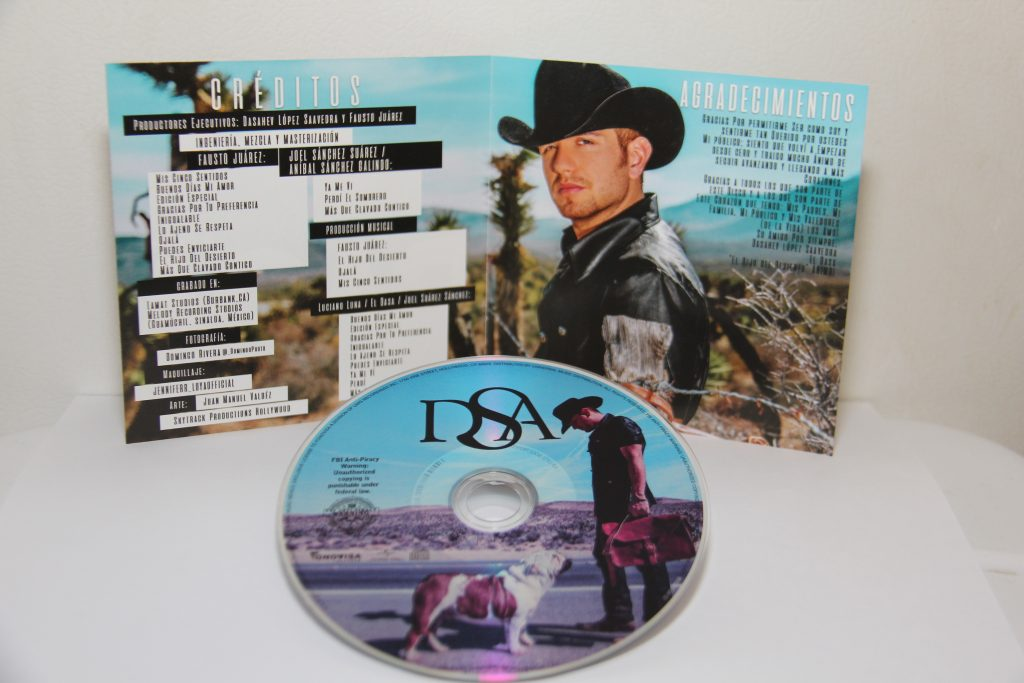 El Hijo Del Desierto Cd Inlay and CD (Photo by: Fredwill Hernandez/The Hollywood 360)